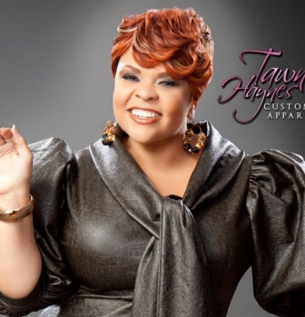 Actress & Recording Artist Tamela Mann in a Tawni Haynes Leather Bow Pencil Dress ($715), Tawni Haynes Edition OMG Accessories, Ring $35, Earrings $25.